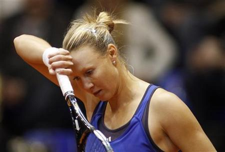 Australia's Alicia Molik reacts during her Fed Cup World Group play-off tennis match against Ukraine's Mariya Koryttseva in Karkiv April 25, 2010. REUTERS/Gleb Garanich