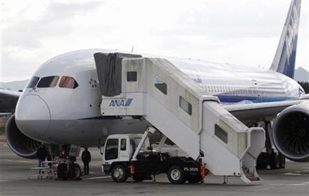 U.S. Federal Aviation Administration (FAA) technical advisor Eric West (L) inspects All Nippon Airways' (ANA) Boeing Co 787 Dreamliner plane which made an emergency landing on Wednesday, at Takamatsu airport in Takamatsu, western Japan January 18, 2013. REUTERS/Issei Kato