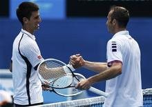 Novak Djokovic of Serbia (L) shakes hands with Radek Stepanek of Czech Republic after defeating him in their men's singles match at the Australian Open tennis tournament in Melbourne January 18, 2013. REUTERS/Tim Wimborne