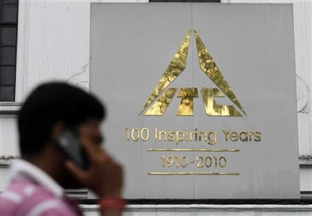 A man talks on his mobile phone as he walks past an ITC office building in Kolkata September 4, 2012. REUTERS/Rupak De Chowdhuri/Files