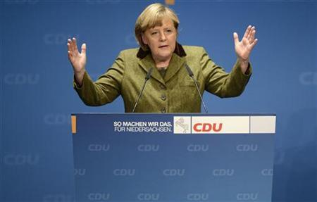 German Chancellor Angela Merkel delivers her speech during an election campaign with Lower Saxony's Christian Democratic state governor David McAllister (CDU) (not pictured) in Stade, January 17, 2013. State elections in Lower Saxony will be held on January 20. REUTERS/Fabian Bimmer (GERMANY - Tags: POLITICS ELECTIONS)