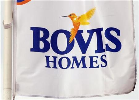 A Bovis homes flag flies at a housing development near Bolton, northern England, July 9, 2008. REUTERS/Phil Noble (BRITAIN)