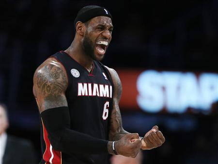 Miami Heat's LeBron James celebrates during their NBA basketball game against the Los Angeles Lakers in Los Angeles January 17, 2013. REUTERS/Lucy Nicholson