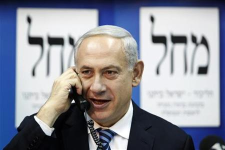 Israel's Prime Minister Benjamin Netanyahu (C) speaks on the phone to persuade citizens to vote for his party at the Likud-Yisrael Beitenu headquarters in Tel Aviv January 17, 2013. REUTERS/Baz Ratner