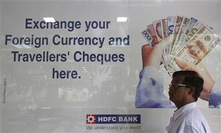A customer walks outside an HDFC Bank branch in Mumbai November 17, 2012. REUTERS/Vivek Prakash/Files