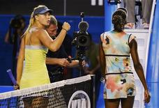 Maria Sharapova of Russia (L) celebrates defeating Venus Williams of the U.S. (R) in their women's singles match at the Australian Open tennis tournament in Melbourne January 18, 2013. REUTERS/Toby Melville
