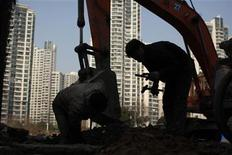 A labourer works at a residential construction site in Shanghai January 18, 2013. REUTERS/Aly Song (CHINA - Tags: BUSINESS CONSTRUCTION)
