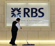 A worker sweeps in the foyer of a Royal Bank of Scotland office in the City of London August 6, 2010. REUTERS/Luke MacGregor