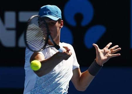 Bernard Tomic of Australia hits a return to Daniel Brands of Germany during their men's singles match at the Australian Open tennis tournament in Melbourne January 17, 2013. REUTERS/David Gray