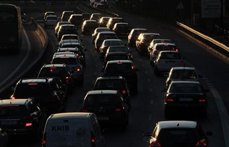 Drivers sit in traffic during morning rush hour as they enter Madrid on highway A-6 February 8, 2011. REUTERS/Susana Vera