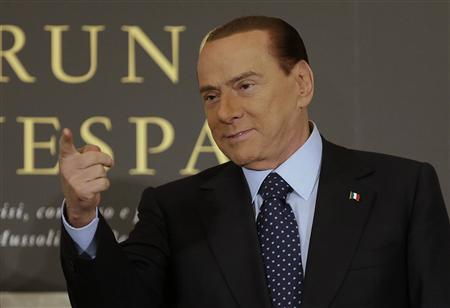 Former Italian Prime Minister Silvio Berlusconi gestures as he arrives to attend the book launch of his friend, TV presenter Bruno Vespa, in Rome December 12, 2012. REUTERS/Tony Gentile