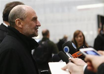 Herman Nackaerts, head of a delegation of the International Atomic Energy Agency (IAEA), speaks to journalists at the airport in Vienna after arriving from Iran January 18, 2013. REUTERS/Leonhard Foeger