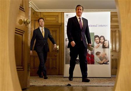 Britain's Prime Minister, David Cameron (R), and Deputy Prime Minister, Nick Clegg, arrive for a news conference in 10 Downing Street in central London January 7, 2013 REUTERS/Peter Nicholls/Pool