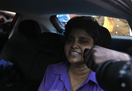 Former chief justice Shirani Bandaranayake speaks to media as she leaves the official residence of the chief justice in Colombo January 15, 2013. REUTERS/Dinuka Layanawatte