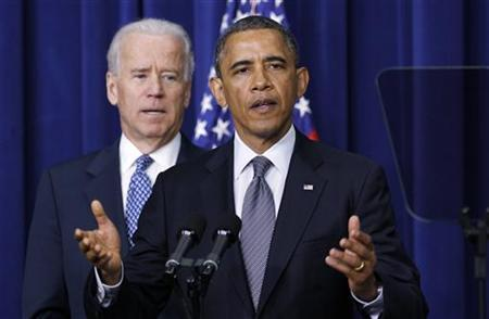U.S. President Barack Obama (R) and Vice President Joe Biden announce a series of proposals to counter gun violence during an event at the White House in Washington January 16, 2013. REUTERS/Kevin Lamarque