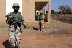 Nigerian soldiers patrol at the Mali air force base near Bamako as troops await their deployment January 18, 2013. REUTERS/Eric Gaillard