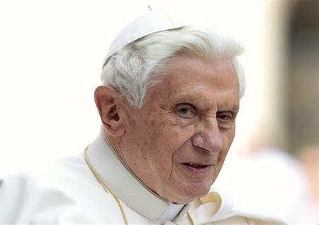 Pope Benedict XVI arrives to lead his weekly audience in St. Peter's Square at the Vatican April 4, 2012. REUTERS/Stefano Rellandini