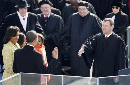 Barack Obama takes the Oath of Office as the 44th President of the United States as he is sworn in by U.S. Chief Justice John Roberts (R) during the inauguration ceremony in Washington, January 20, 2009. REUTERS/Rick Wilking
