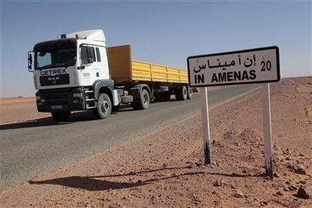 A truck passes by a road sign indicating In Amenas, about 100 km (60 miles) from the Algerian and Libyan border, where Islamist militants were holding foreigners hostage, January 18, 2013. REUTERS/Ramzi Boudina