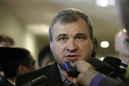 Russian Ambassador to UN Andrei Denisov talks to reporters after leaving a meeting of the five permanent members of the Security Council at U.N. headquarters in New York in this March 29, 2006 file photo. REUTERS/Keith Bedford
