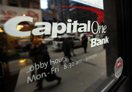 People walk past a Capital One banking center in New York's financial district January 17, 2013. REUTERS/Brendan McDermid