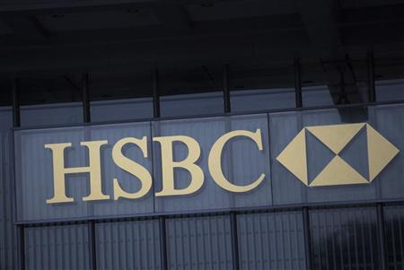 The logo of HSBC is seen on a building in Hong Kong January 9, 2013. REUTERS/Tyrone Siu