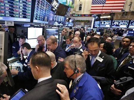 Traders work on the floor of the New York Stock Exchange, January 18, 2013. REUTERS/Brendan McDermid