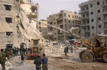 Rescuers search for casualties at a damaged building after a large blast hit a neighbourhood of the Syrian city of Aleppo January 18, 2013. REUTERS/George Ourfalian