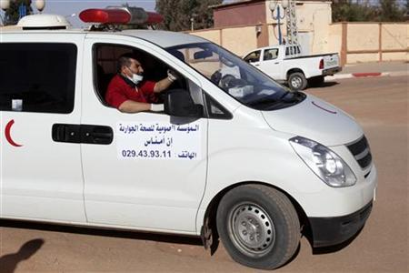 An ambulance believed to be carrying a wounded hostage from a gas facility where Islamist militants were holding them, is seen arriving at a hospital in In Amena January 18, 2013. REUTERS/Ramzi Boudina