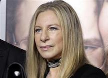 "Barbra Streisand, star of the new film ""The Guilt Trip"" poses on the arrivals line at the film's premiere in Los Angeles December 11, 2012. REUTERS/Fred Prouser"