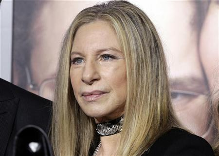 Barbra Streisand, star of the new film ''The Guilt Trip'' poses on the arrivals line at the film's premiere in Los Angeles December 11, 2012. REUTERS/Fred Prouser