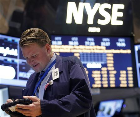 Trader John Bowers of Bowers Securities works on the floor of the New York Stock Exchange, January 18, 2013. REUTERS/Brendan McDermid
