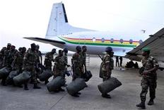 Benin soldiers stand in preparation to leave for their deployment to Mali, in the capital Cotonou January 18, 2013. The contingent of around 30 Benin troops will leave Cotonou for the Mali capital Bamako. REUTERS/Charles Placide