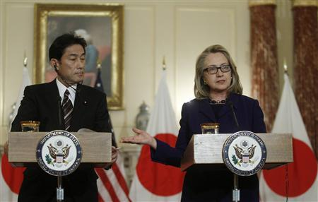 U.S. Secretary of State Hillary Clinton (R) gestures during a joint news conference with Japan's Foreign Minister Fumio Kishida after their meeting at the State Department in Washington January 18, 2013. REUTERS/Gary Cameron