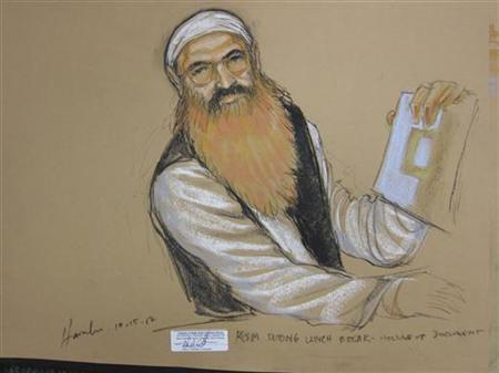 Khalid Sheikh Mohammed holds up a piece of paper in this artist's sketch during a court recess at pre-trail hearing at the U.S. Naval Base Guantanamo Bay, Cuba, October 15, 2012. REUTERS/Janet Hamlin/Files