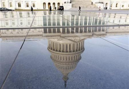 The dome of the U.S. Capitol is reflected on the first day of the 113th Congress in Washington January 3, 2013. REUTERS/Kevin Lamarque
