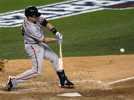 San Francisco Giants' Buster Posey hits a two-run home run against the Detroit Tigers in the sixth inning during Game 4 of the MLB World Series baseball championship in Detroit, Michigan, October 28, 2012. REUTERS/Rebecca Cook