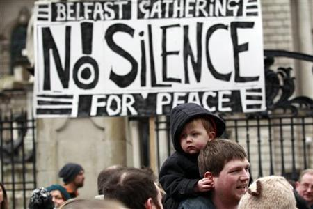 Demonstrators attend a peace rally at Belfast City Hall in this file photo taken January 13, 2013. REUTERS/Cathal McNaughton