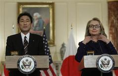 U.S. Secretary of State Hillary Clinton (R) meets Japan's Foreign Minister Fumio Kishida at the State Department in Washington January 18, 2013. REUTERS/Gary Cameron