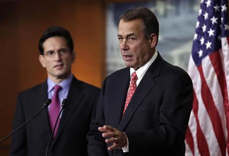 U.S. House Speaker John Boehner (R-OH) (R) and House Majority Leader Eric Cantor (R-VA) speak to the media on the ''fiscal cliff'' on Capitol Hill in Washington, December 21, 2012. REUTERS/Yuri Gripas