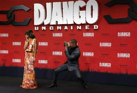 Cast members Kerry Washington (L) and Jamie Foxx pose on the red carpet for the German premiere of ''Django Unchained'' in Berlin January 8, 2013. REUTERS/Tobias Schwarz