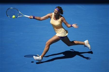 Victoria Azarenka of Belarus hits a return to Jamie Hampton of the U.S. during their women's singles match at the Australian Open tennis tournament in Melbourne, January 19, 2013. REUTERS/Daniel Munoz