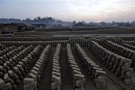 A man works at a brick kiln near Hlawga village, 35 km (22 miles) north of Yangon, January 18, 2013. REUTERS/Soe Zeya Tun