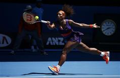 Serena Williams of the U.S. hits a return to Ayumi Morita of Japan during their women's singles match at the Australian Open tennis tournament in Melbourne, January 19, 2013. REUTERS/David Gray