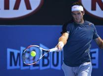 Juan Martin del Potro of Argentina hits a return to Jeremy Chardy of France during their men's singles match at the Australian Open tennis tournament in Melbourne January 19, 2013. REUTERS/Toby Melville