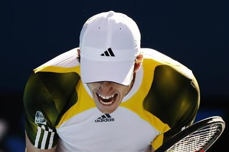 Andy Murray of Britain celebrates defeating Ricardas Berankis of Lithuania during their men's singles match at the Australian Open tennis tournament in Melbourne January 19, 2013. REUTERS/Daniel Munoz