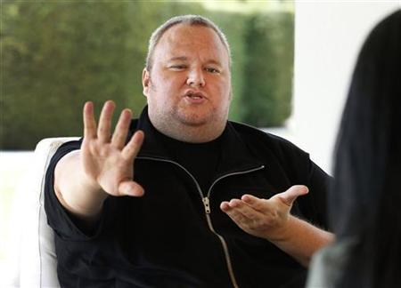 Kim Dotcom gestures as he speaks during an interview with Reuters in Auckland January 19, 2013. REUTERS/Nigel Marple