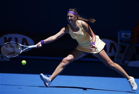 Victoria Azarenka of Belarus hits a return to Jamie Hampton of the U.S. during their women's singles match at the Australian Open tennis tournament in Melbourne, January 19, 2013. REUTERS/David Gray