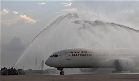 The Air India's Dreamliner Boeing 787 is given a traditional water cannon salute by the fire tenders upon its arrival at the airport in New Delhi September 8, 2012. REUTERS/Mansi Thapliyal/Files
