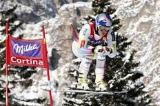 Lindsey Vonn of the U.S. goes airborne during the second training session in the women's downhill event at the Alpine Skiing World Cup in Cortina d'Ampezzo January 18, 2013. REUTERS/Giampiero